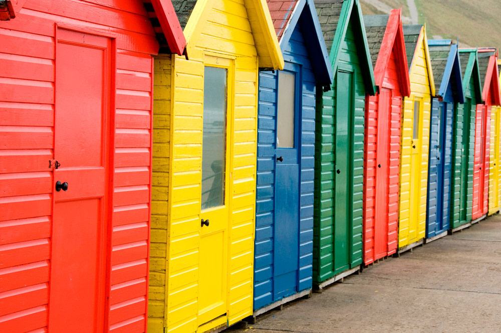 Colorful beach huts in Whitby