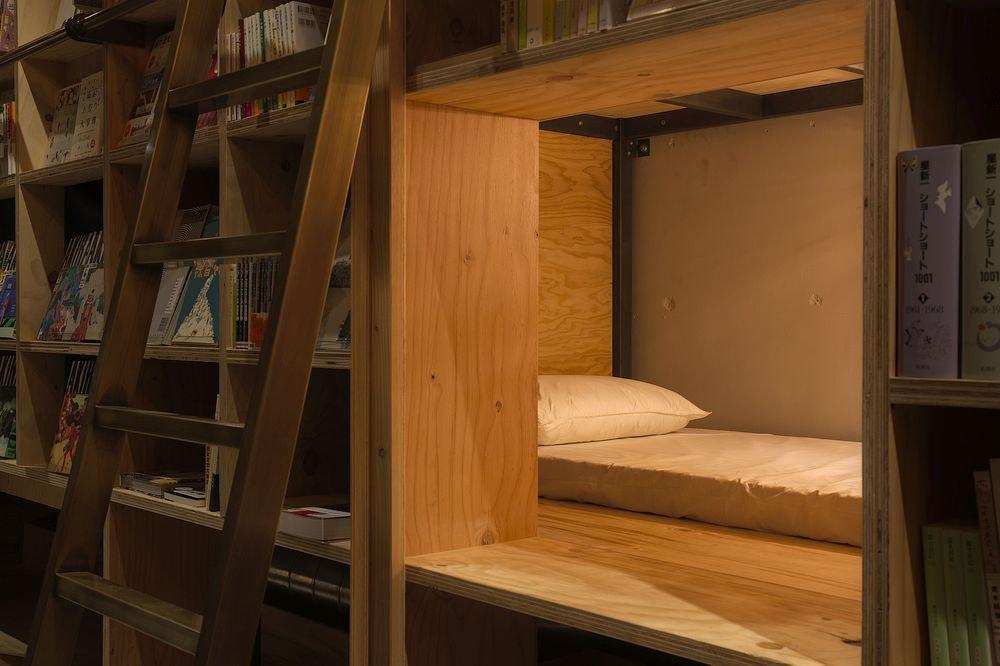 Bed Behind the Bookshelf