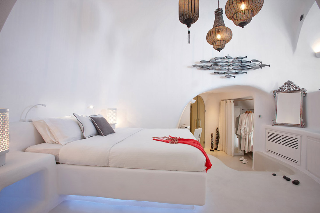 White bedroom with king-size bed