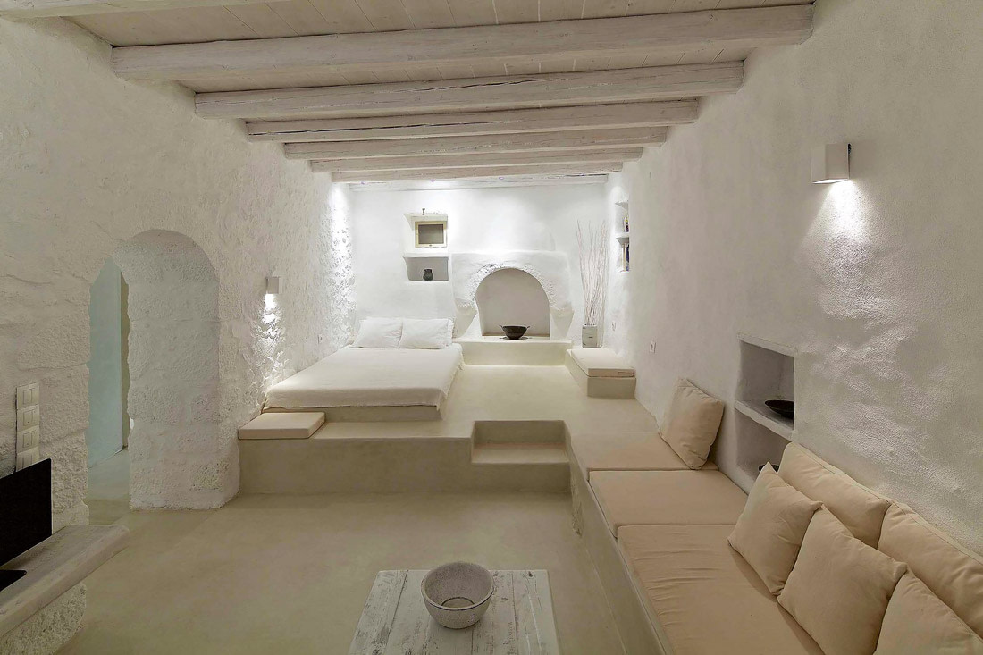 White bedroom with exposed beams