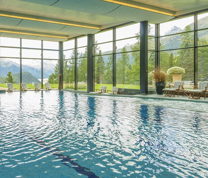 Indoor heated pool with glass walls